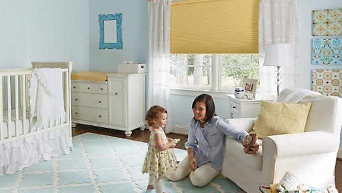 Nursery Room Interior With Buttercream Accordia Custom Levolor Cellular Shades And White Curtain Plus White Wooden Dresser On Wooden Floor Ideas