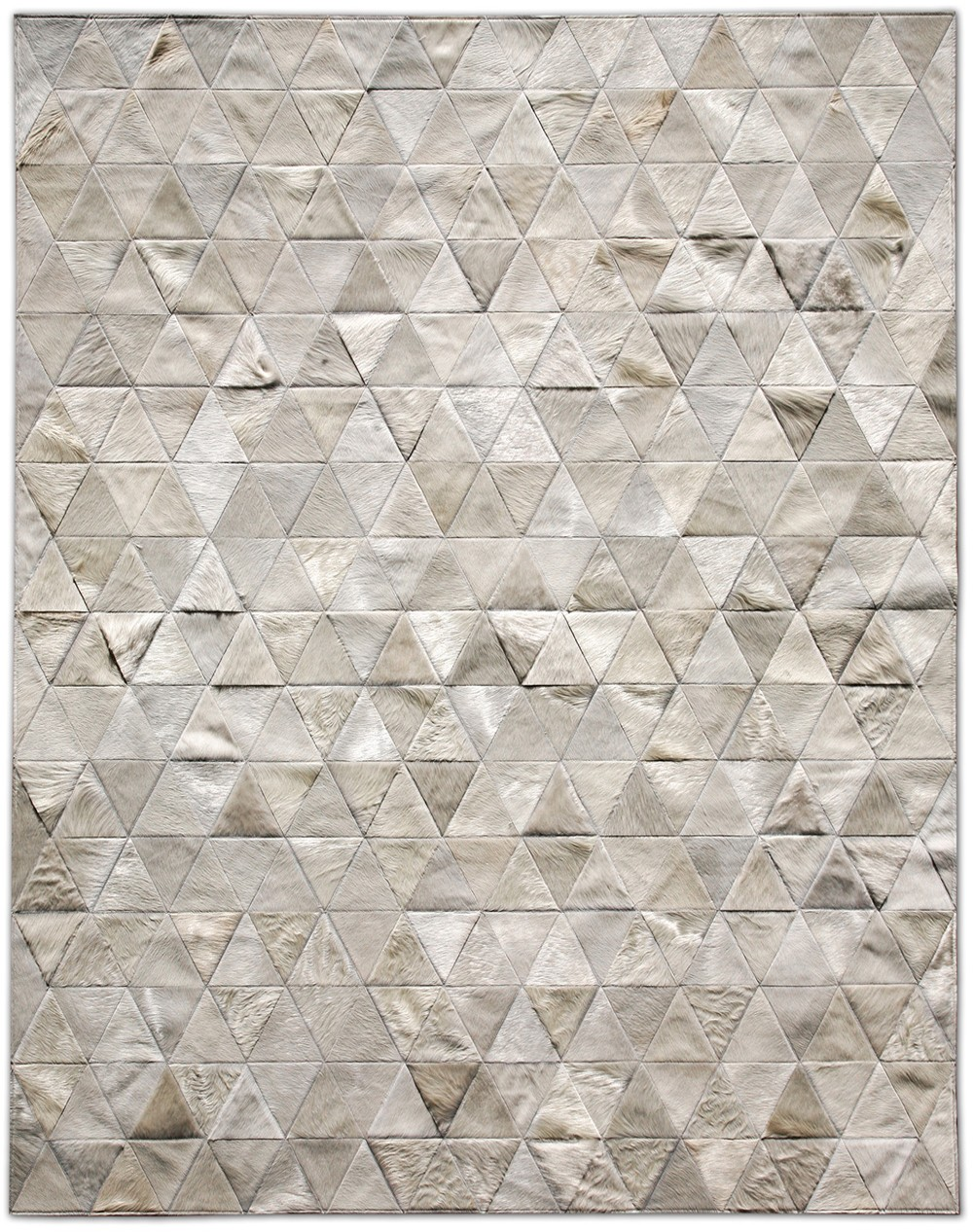 pretty cowhide patchwork rug style in grey and triangle motif for floor decor ideas