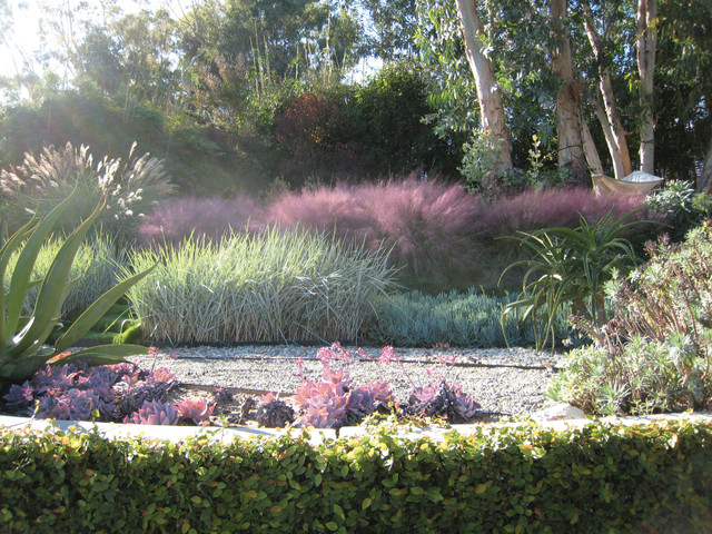 pretty garden decoration with lovely pink muhly grass and tree with swing ideas