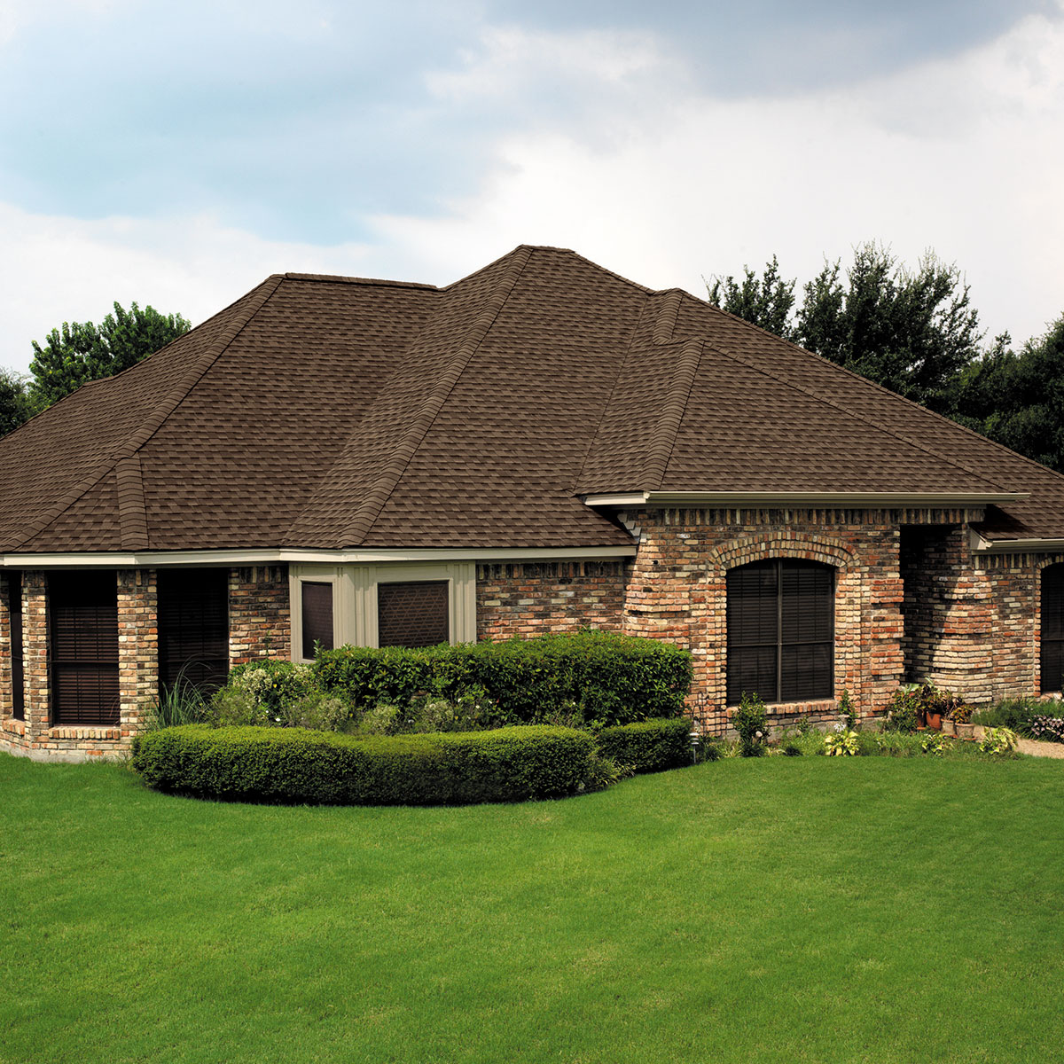 pretty home exterior design using brown gaf timberline hd roof matched with brick wall and wooden windows and door ideas