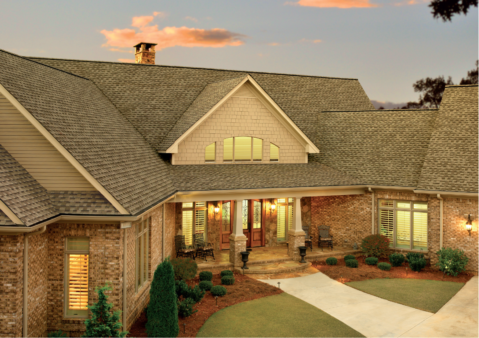 pretty home exterior design using gray gaf timberline hd roofing matched with brick siding and wooden door ideas