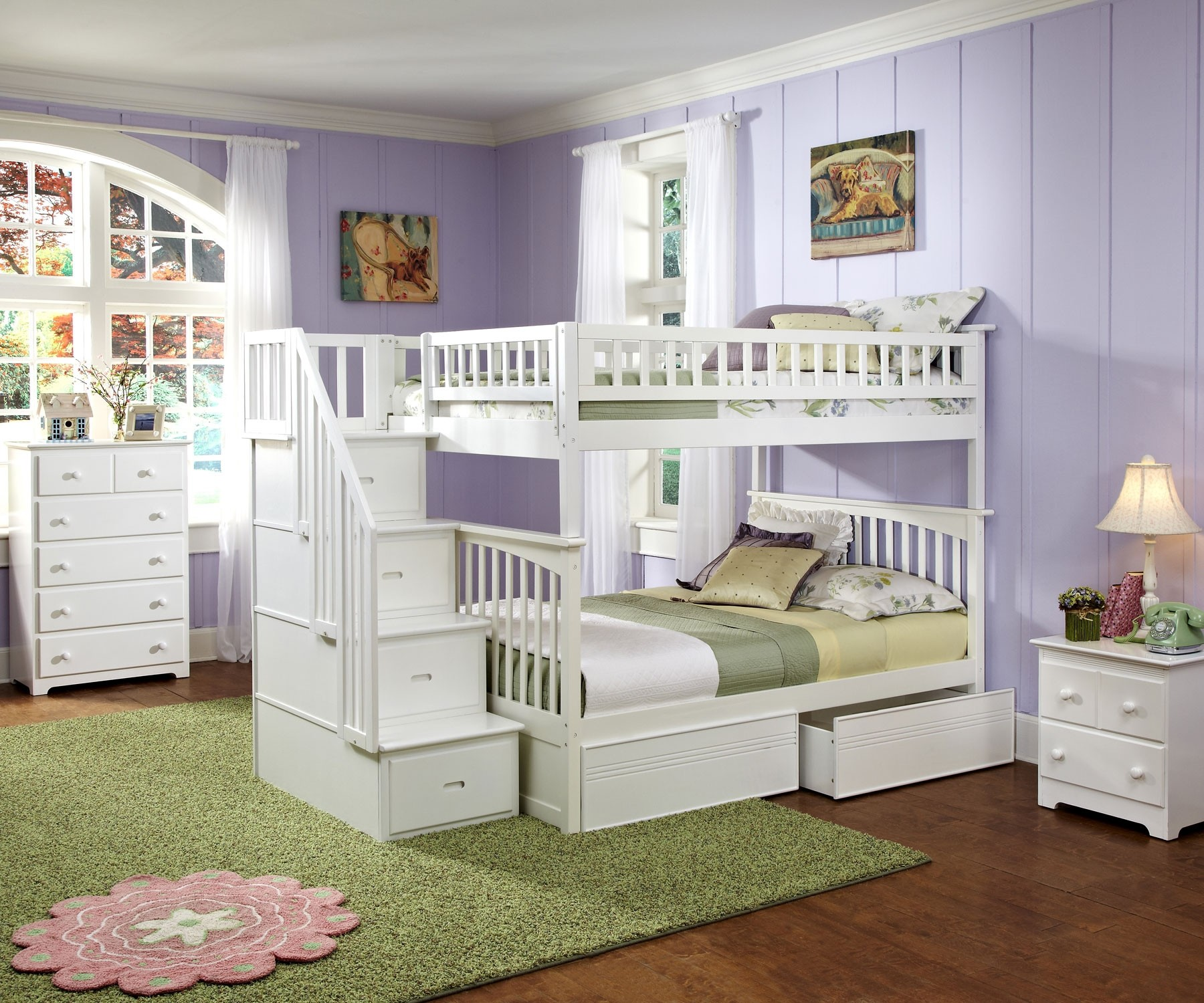 pretty wood Bunk Beds With Stairs in white with storage on wooden floor matched with purple wall with pictures plus chic white wooden dresser for teen bedroom decor ideas