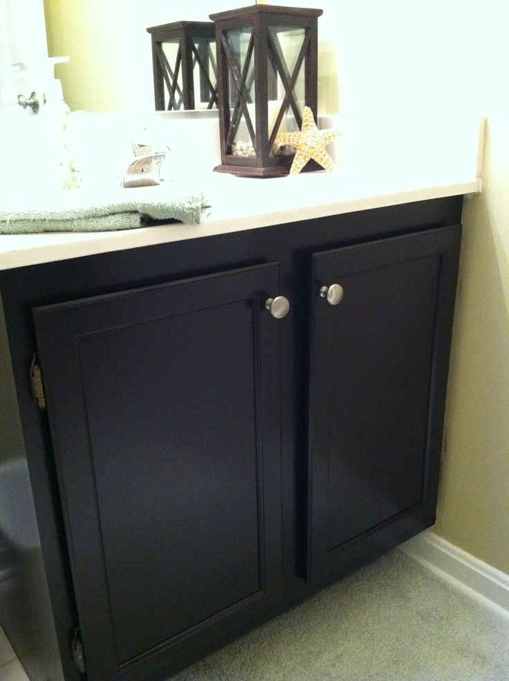 pretty wooden bathroom cabinet general finishes java gel stain in black with silver handle and white top for bathroom furniture ideas