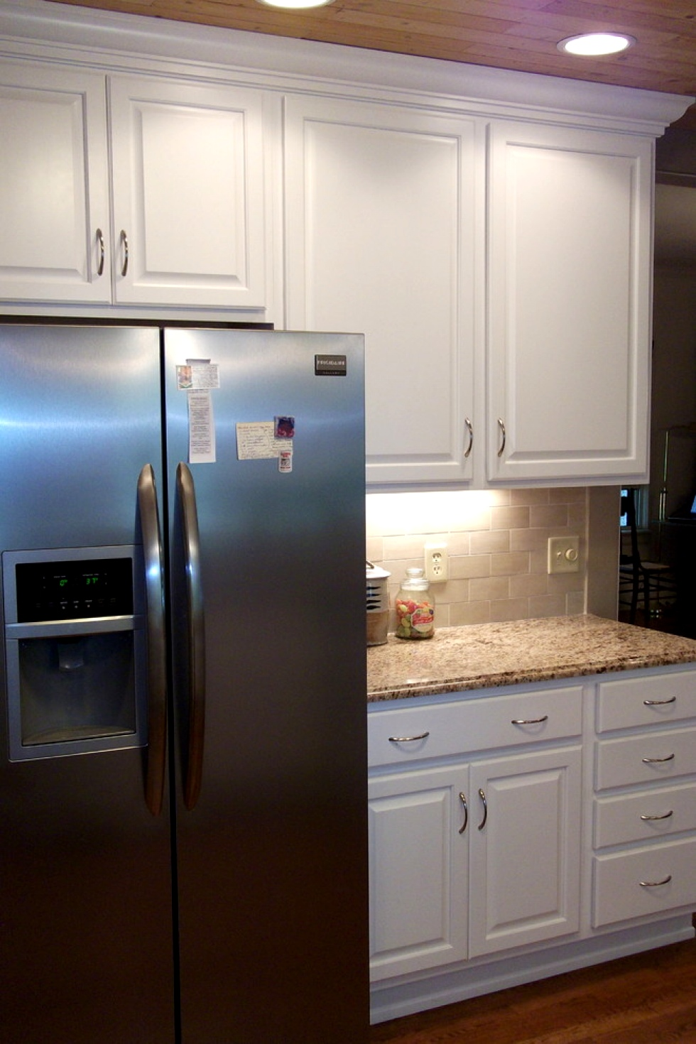 pretty wooden kitchen bertch cabinets in white with silver handle and granite countertop plus fridge for kitchen decor ideas