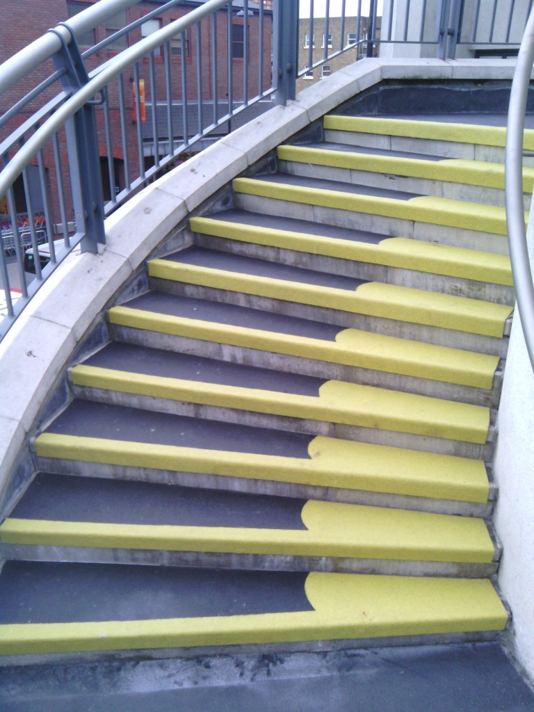 Public Stair Using Non Slip Stair Treads In Black Matched With Metal Railing Ideas