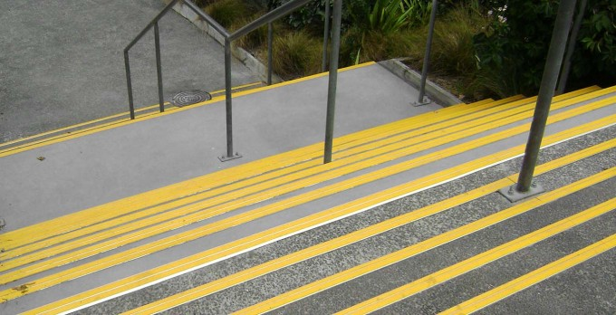 Public Stair Using Yellow Non Slip Stair Treads And Metal Handrailing Ideas