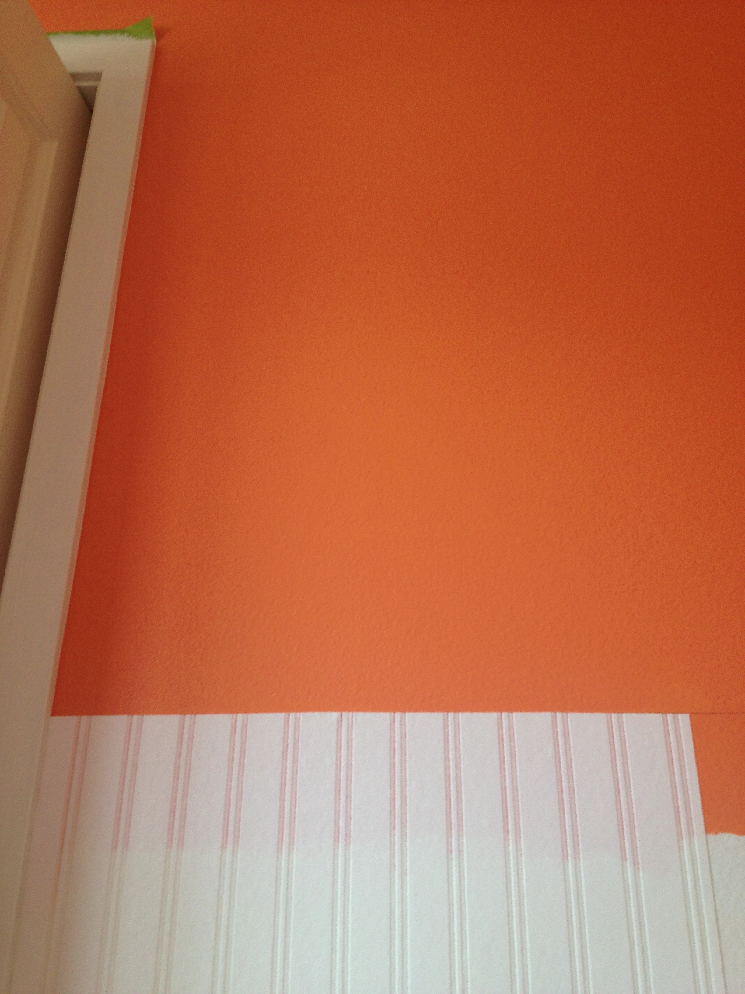 Renovating the orange wall using white Wall Doctor Beadboard Wallpaper to get prettier look
