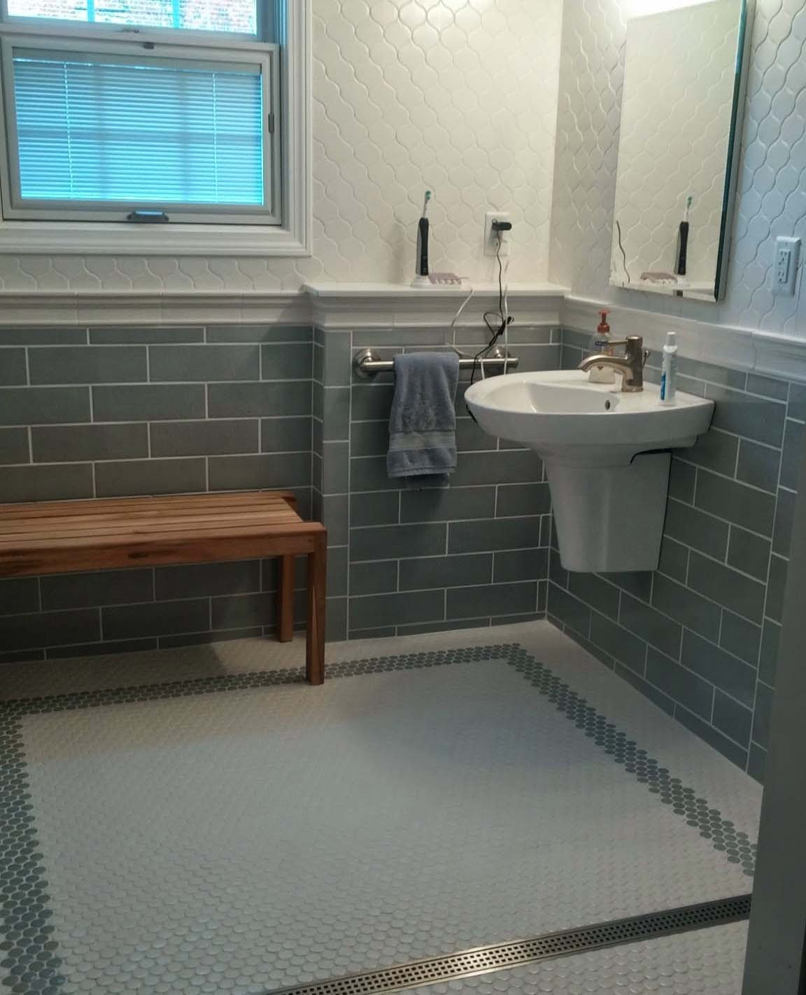 Schluter systems bathroom with Walker Zanger tile Slide show plus sink and wooden bench for bathroom decor ideas