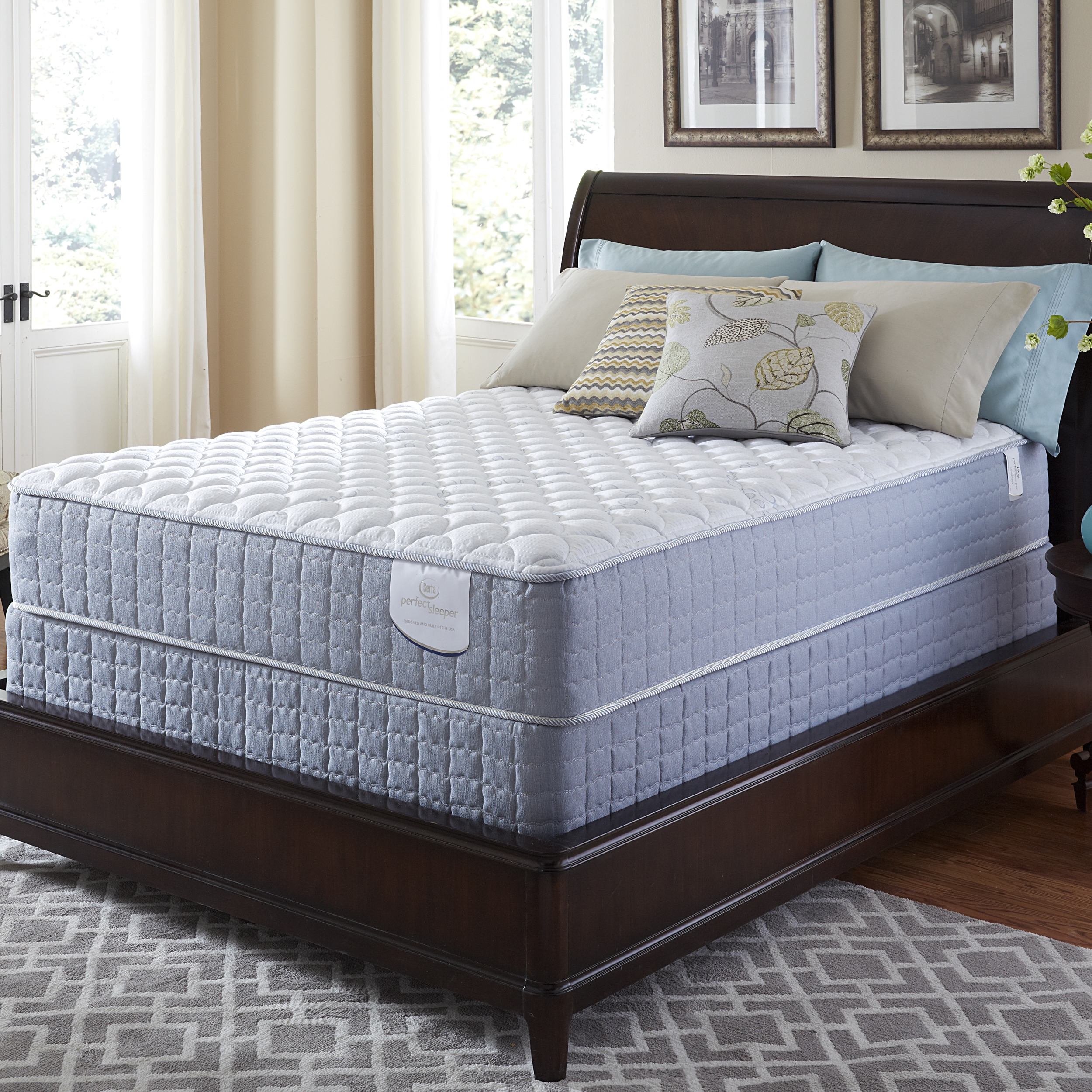 serta perfect sleeper luminous cushion firm king size mattress and pillows with brown headboard before the