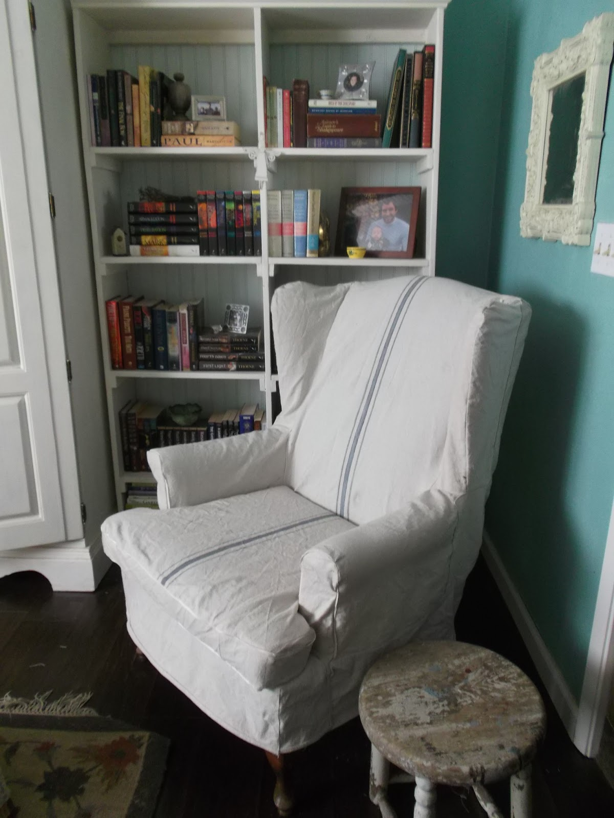 Single Sofa With Wingback Chair Slipcover In White On Wooden Floor Matched  With Green Wall Plus