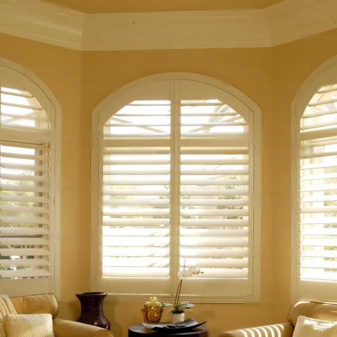 Specialty Shaped Window Sunburst Shutters On Cream Wall With Decorative Trim Board Plus Sofa Set For Interior Design Ideas