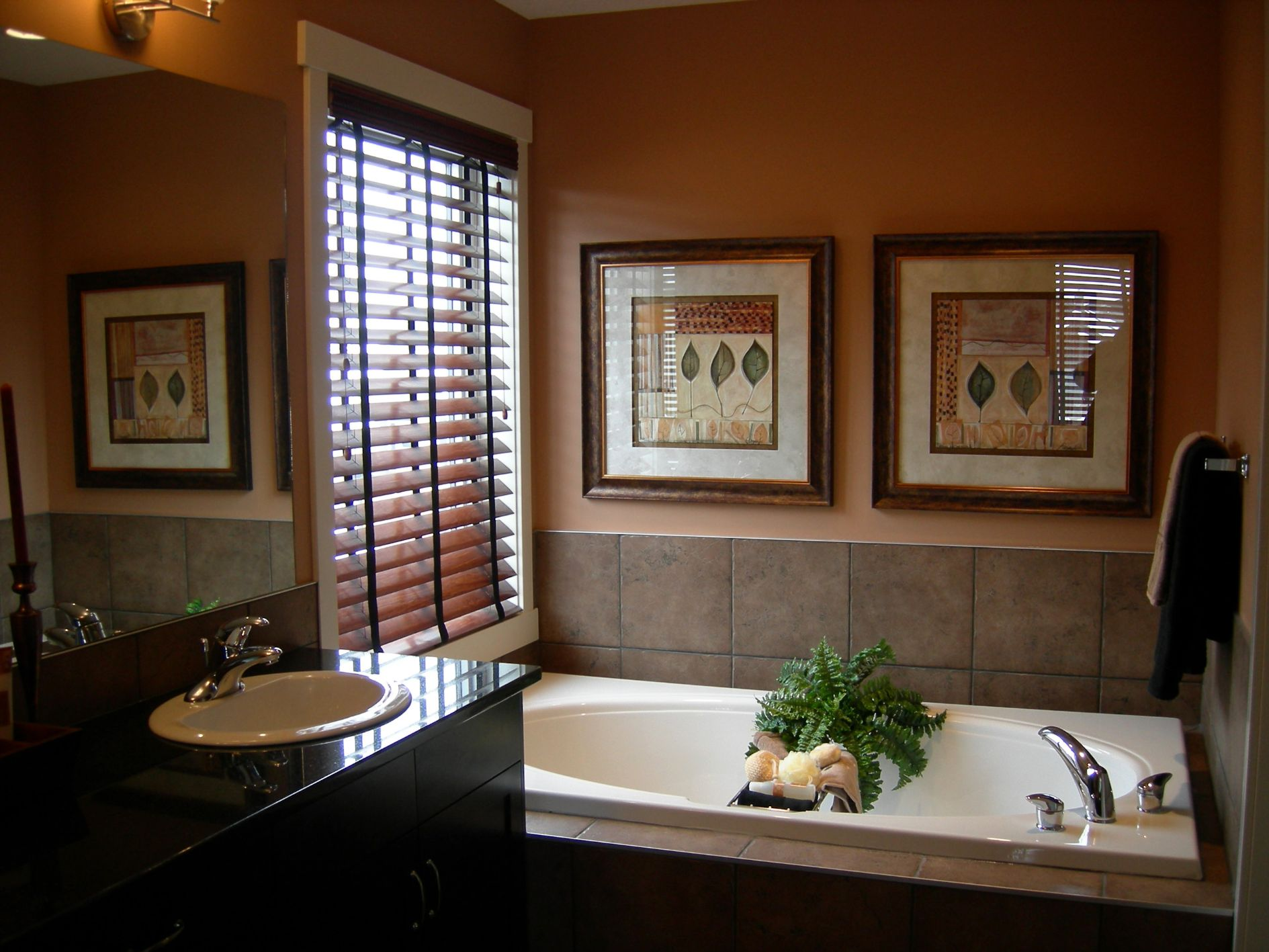 tan wall with glass window and faux wood blinds plus bathup and kitchen cabinet with sink and faucet for bathroom decor ideas