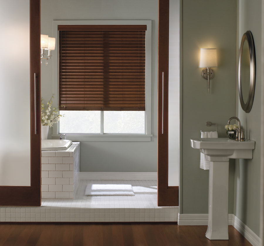 white bathroom with bathup white window with brown faux wood blinds ideas