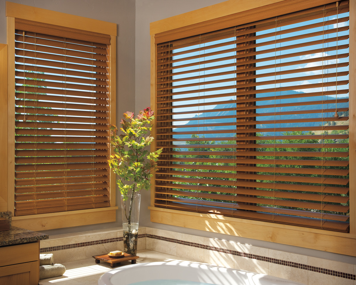 white bathup before the tan wall with window and brown faux wood blinds for bathroom decor ideas