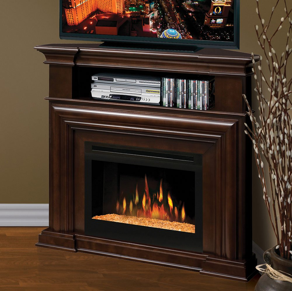 Wonderful Corner Dimplex Electric Fireplaces With Brown Wood Mantel Kit With Dvd Stand Before The Tan Wall Matched With Wooden Floor For Family Room Decor Ideas