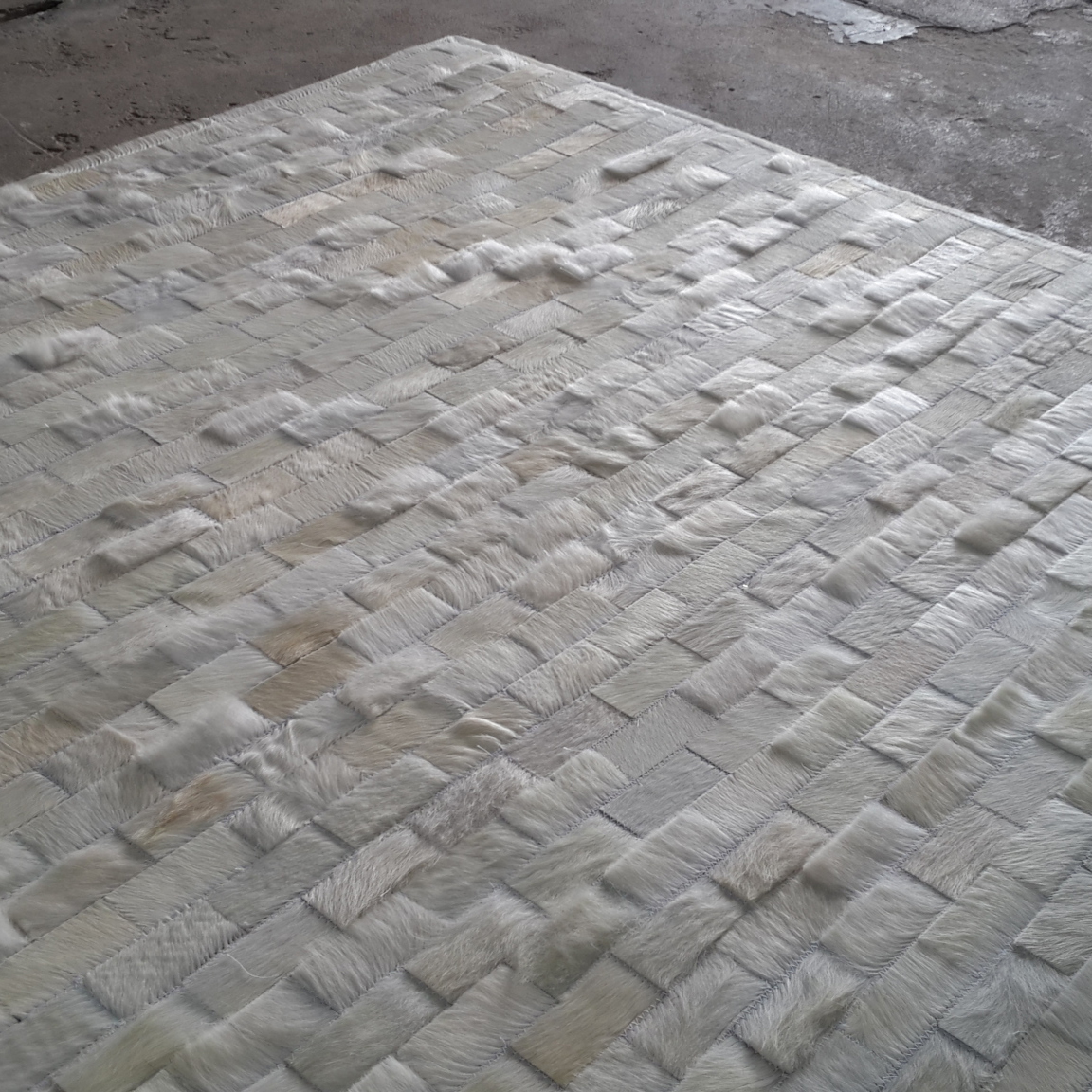 wonderful cowhide patchwork rug in creamy white with rectangular motif for floor decor ideas