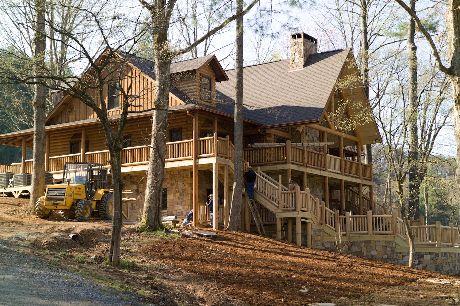 wonderful exterior design of Southland Log Homes in double tier design with railing and glass windows ideas