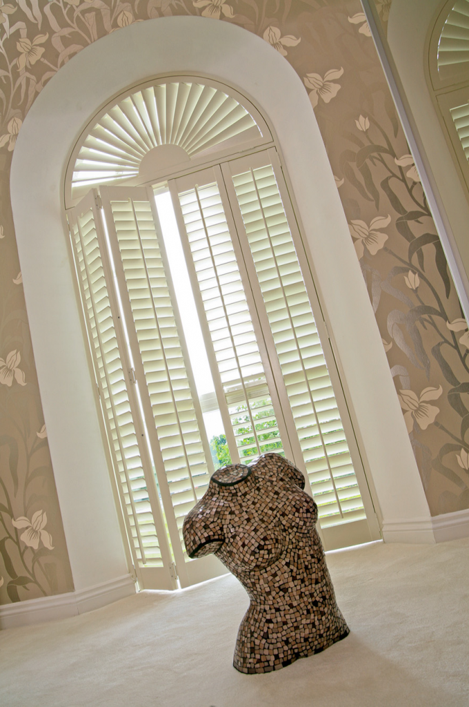 Wonderful Sunburst Shutters In White With Arch And Cute Floral Wallpaper Matched With White Tile Floor For Exciting Home Interior Design Ideas