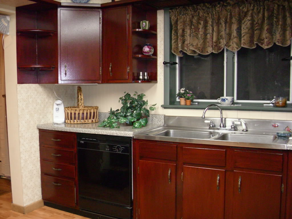 wonderful wooden kitchen cabinet using minwax gel stain with granite countertop and stainless steel sink plus silver faucet for kitchen decor ideas