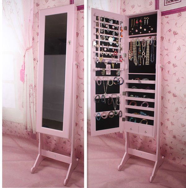 wonderful wooden standing mirror jewelry armoire in pink before the pink floral wallpaper for living room decor ideas