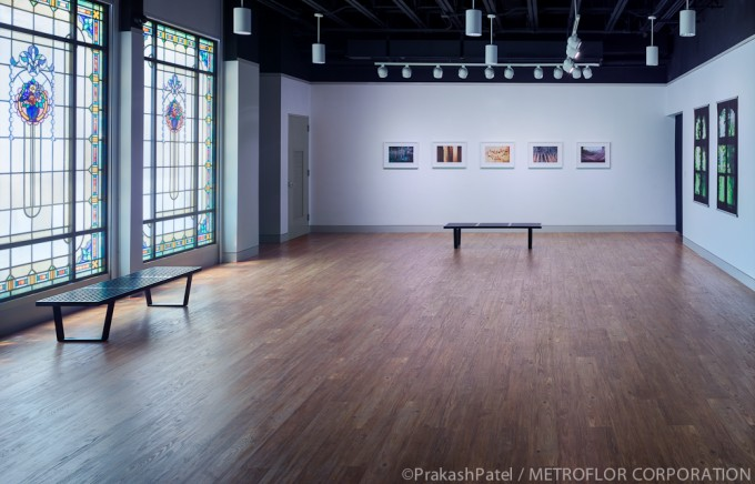 Wooden Floor By Konecto Matched With White Wall And Chandelier For Gallery Decor Ideas