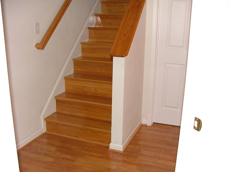wooden floor by Konecto matched with white wall and wooden stair for home interior design ideas