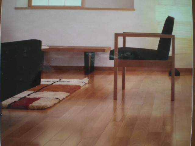 wooden floor by Konecto matched with white wall plus chair and rug for living room decor ideas