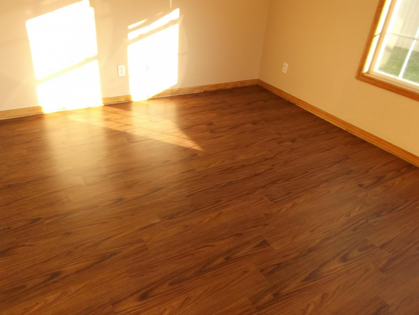 Wooden Flooring By Konecto Matched With White Wall And Baseboard Molding For Home Interior Design Ideas