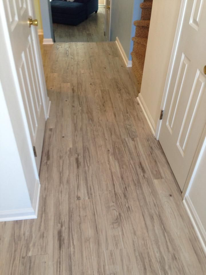 Wooden Konecto Flooring Matched With White Wall And White Door For Home Interior Design Ideas