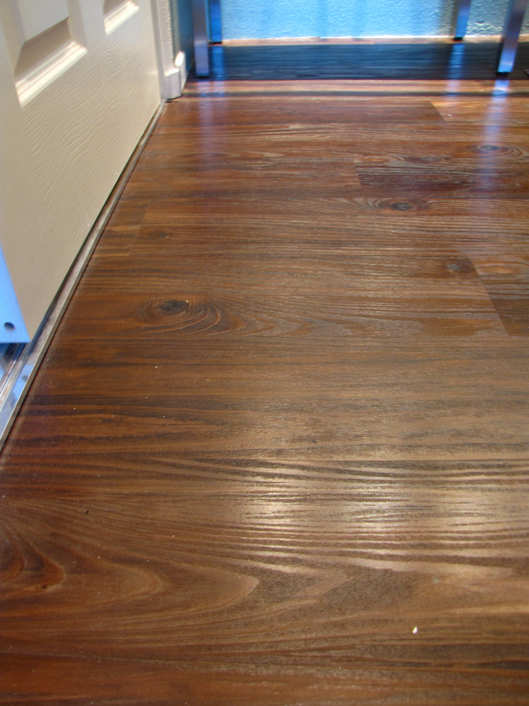 Wooden Konecto Flooring Matched With White Wall For Home Interior Design Ideas