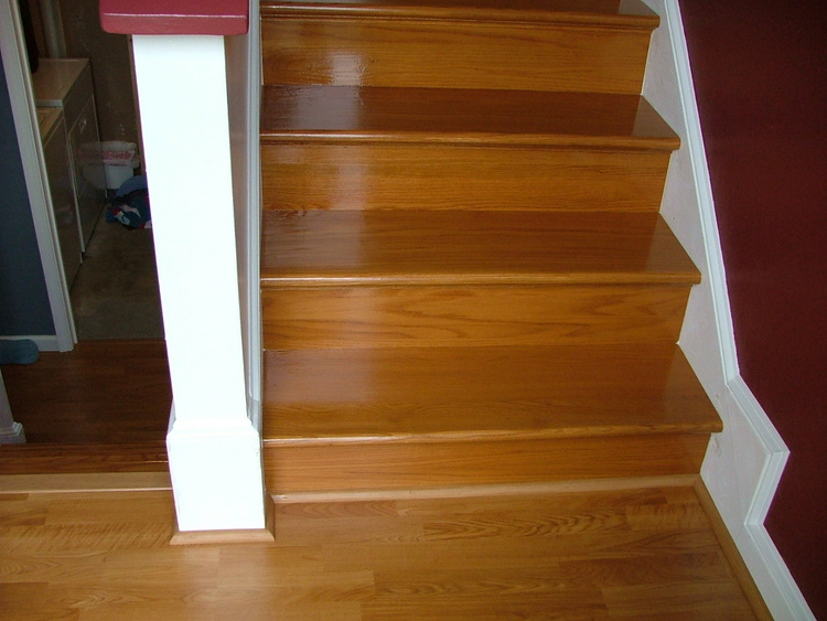 wooden sandy brown wooden flooring by Konecto and stair with white railing for home interior design ideas