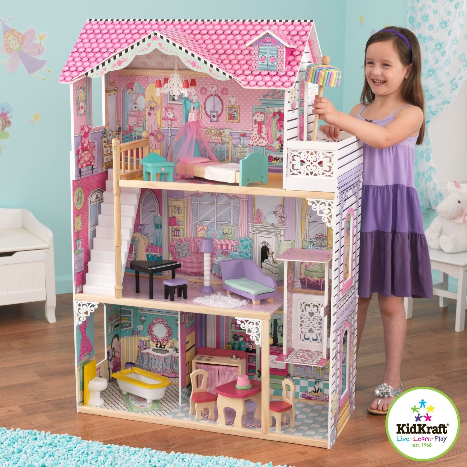 Amazing Kidkraft Dollhouse Made Of Wood With Triple Tier Design With Pink Roof On Wooden Floor Which Matched With Blue Wallpaper For Nursery Decor Ideas