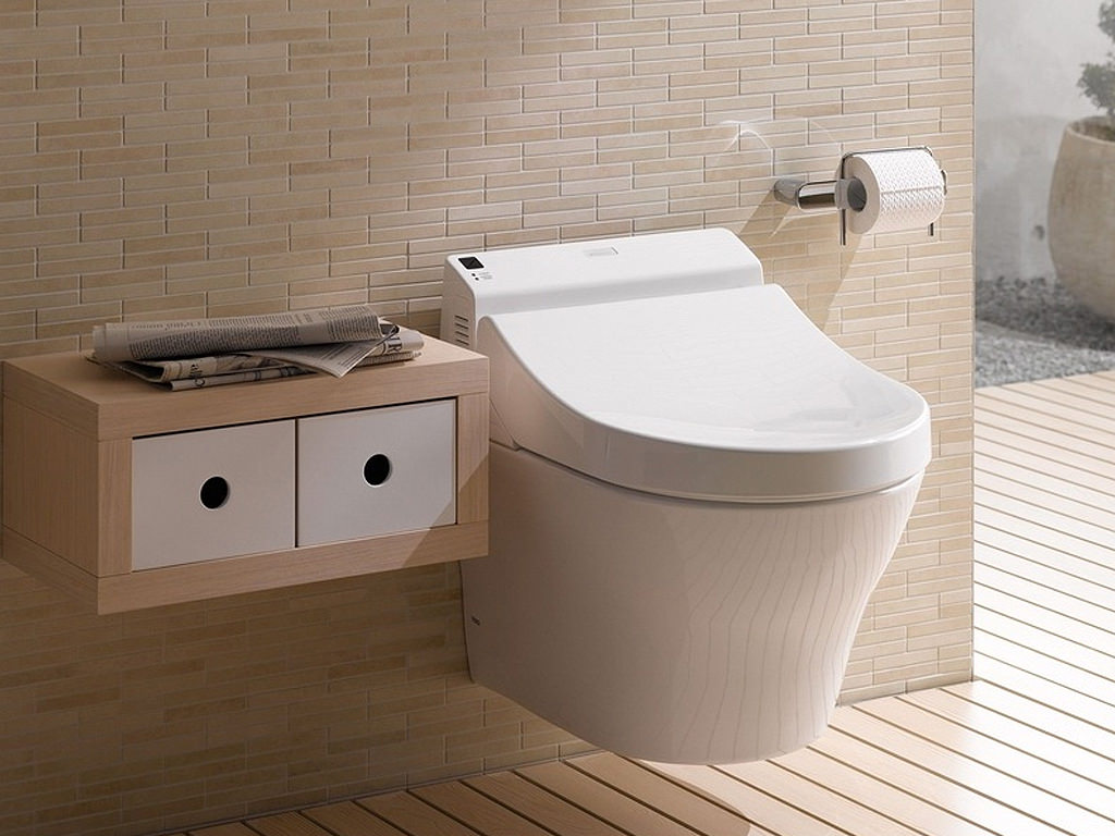 Awesome Bathroom Decor With Beige Tile Wall Matched With Wooden Floor Plus Floating Toto Washlet And Small Cabinet Ideas