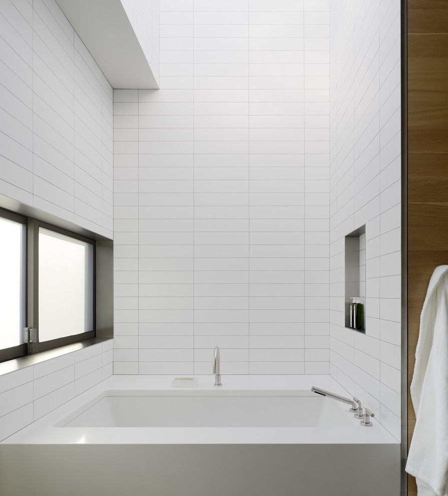 awesome bathroom design with white tile wall with schluter strip plus white tub with faucet ideas