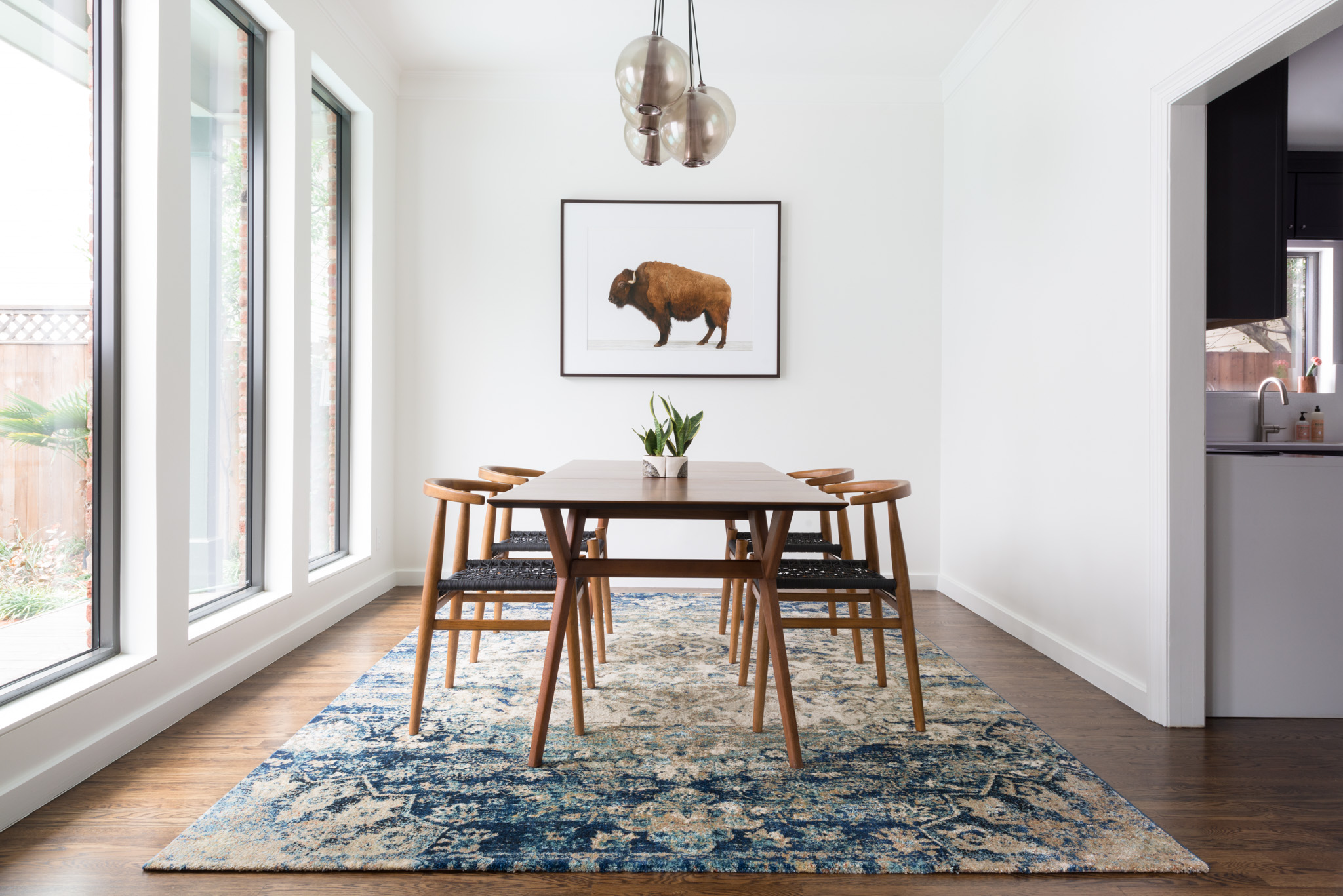 awesome blue loloi rugs on wooden floor which matched with white wall plus dining table set for lovely dining room decor ideas