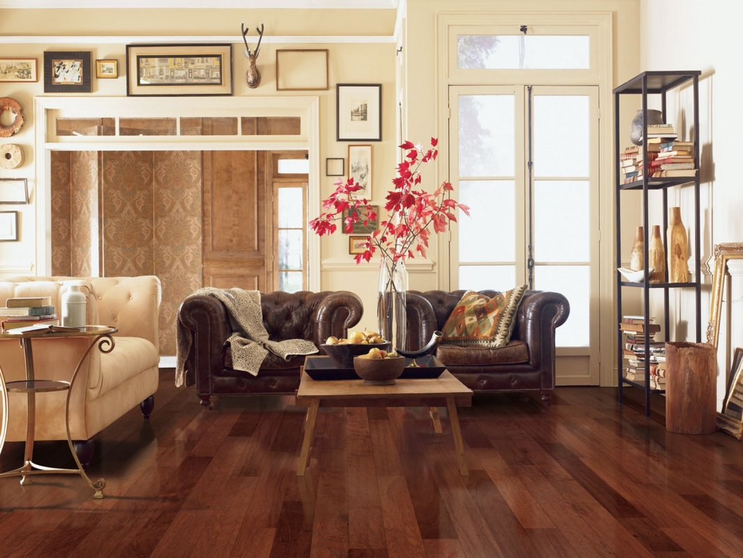 awesome brown wood Mohawk Flooring matched with white wall plus brown leather sofa for living room decor ideas