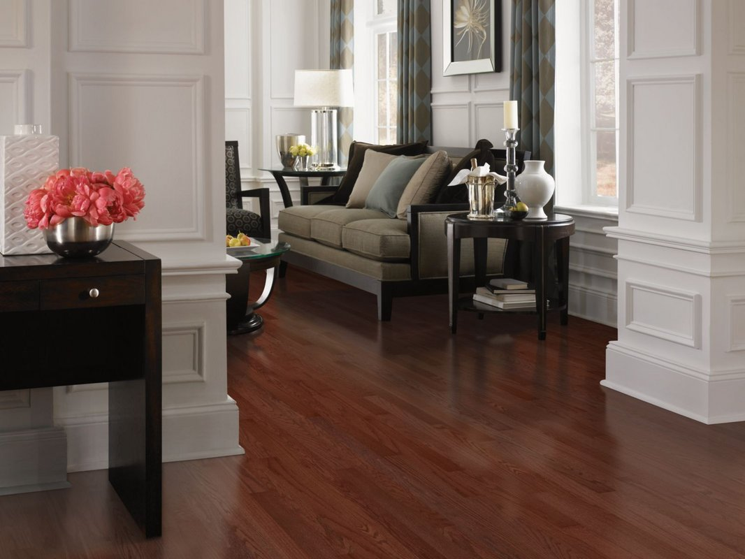 awesome brown wooden Mohawk Flooring matched with decorative wainscoting plus sofa set for living room decor ideas