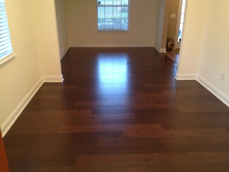 awesome brown wooden mohawk flooring matched with white wall and baseboard molding for home interior design ideas