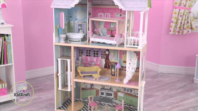 Awesome Kidkraft Majestic Mansion Dollhouse 65252 Made Of Wood On Wooden Floor Matched With Pink Wall And Baseboard Molding For Kids Room Decor Ideas