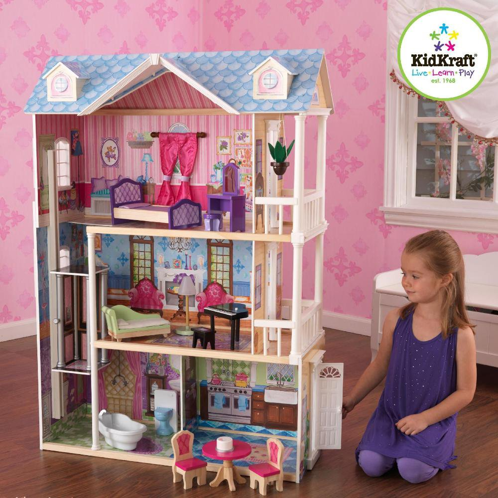 awesome kidkraft majestic mansion dollhouse 65252 made of wood with blue roof on wooden floor matched with pink wallpaper for kids room decor ideas