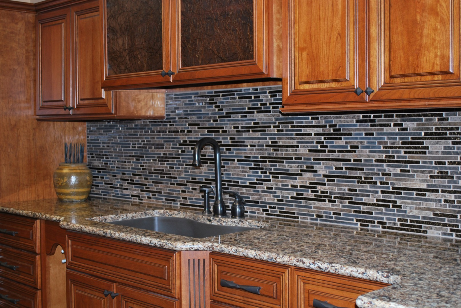 Awesome Kitchen Decor With Wooden Kitchen Cabinet And Granite Countertop Plus Mosaic Tile Backsplash With Schluter Strip Ideas
