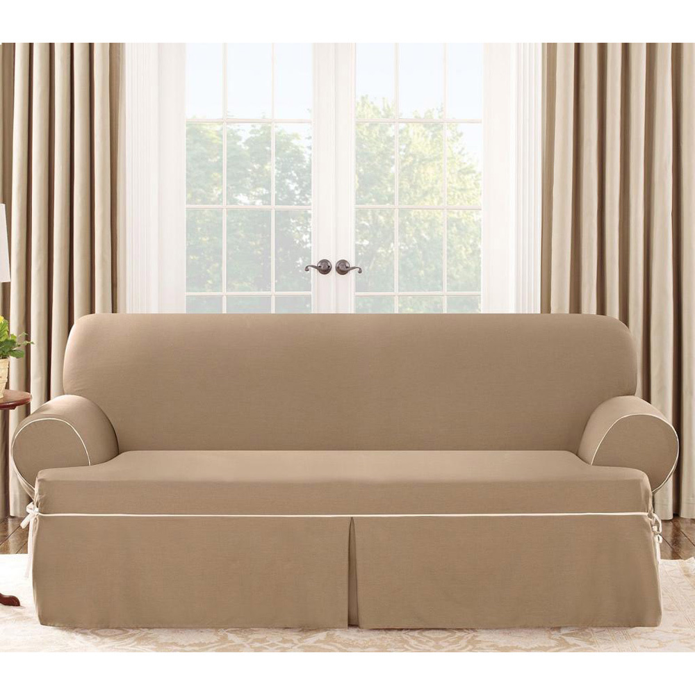 awesome sofa with tan surefit cover before the glass window with curtain for living room decor ideas