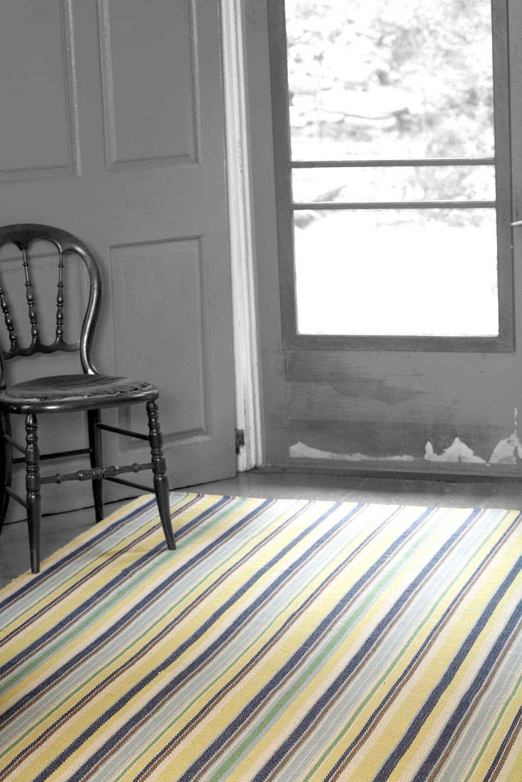 Awesome Stripped Dash And Albert Rugs On Wooden Floor Matched With White Door For Interior Design Ideas