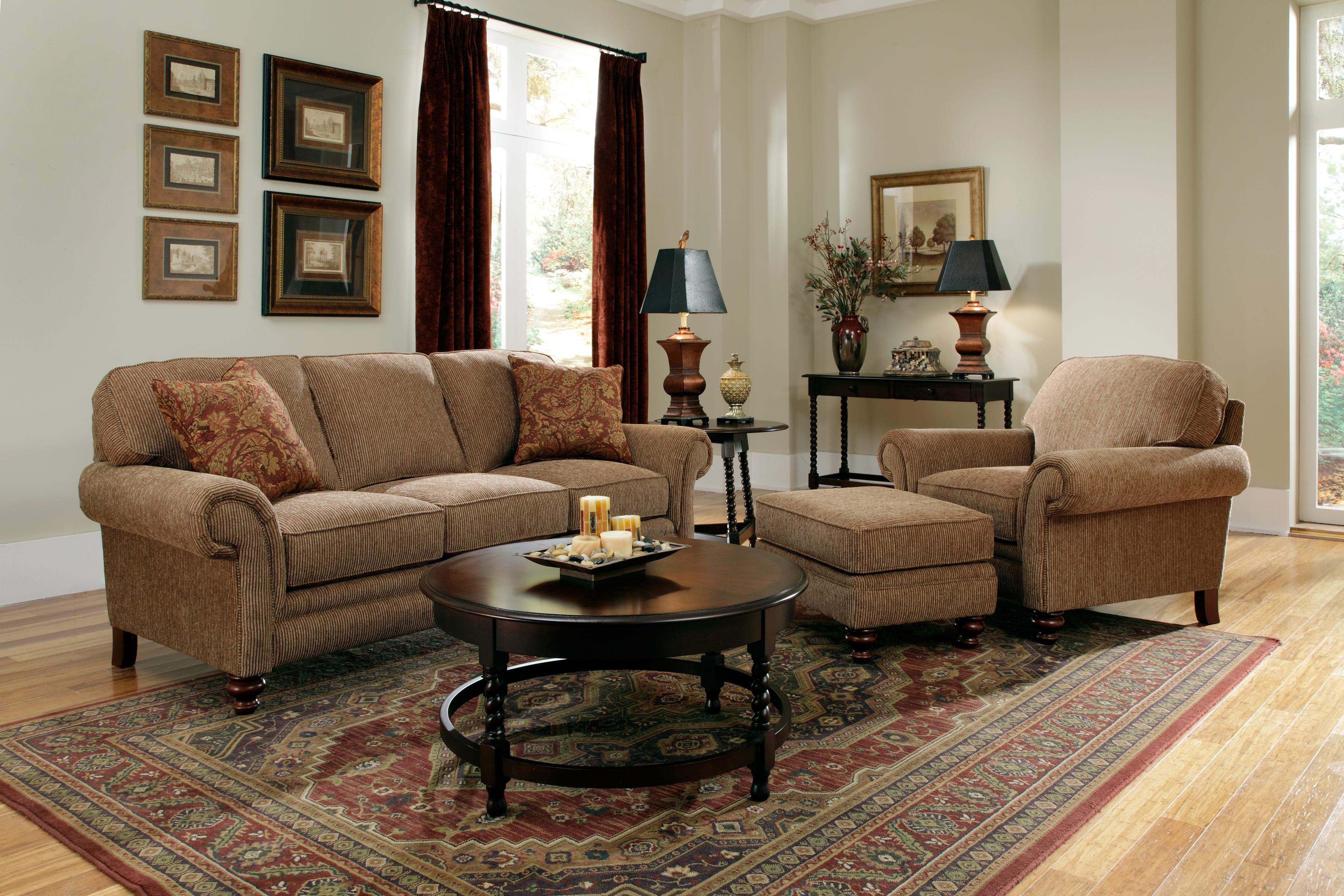 awesome tan sofa set with round wooden table by broyhill furniture on floral rug for living room decor ideas