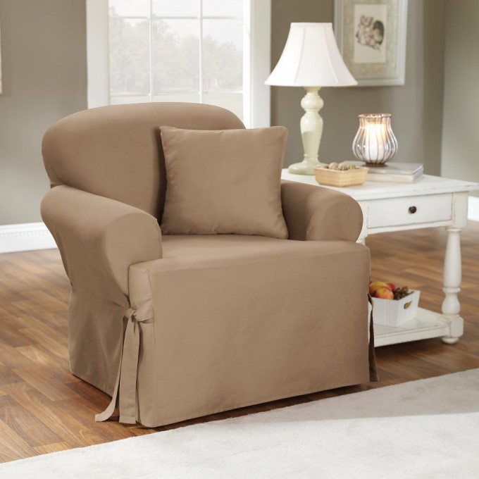 Awesome Wing Back Chair With Surefit Cover In Tan Next To A White Wooden Nightstand With White Table Lamp For Living Room Decor Ideas