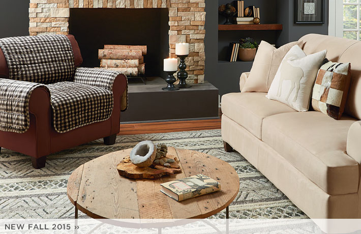 beautiful sofa with surefit cover plus cute rug on wooden floor for living room decor ideas