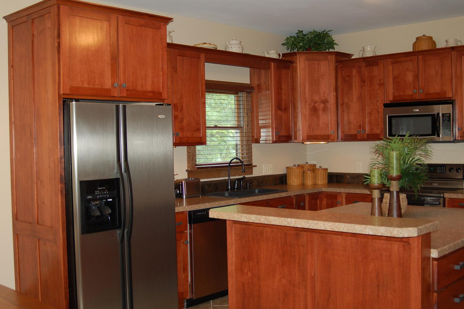 Charming Brown Wooden Kitchen Cabinet With Wilsonart Laminate Countertops And Silver Fridge For Kitchen Decor Ideas
