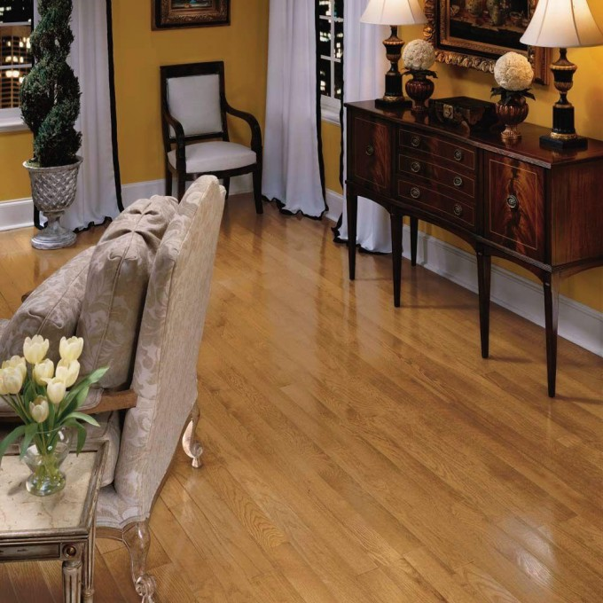Charming Bruce Hardwood Floors Matched With Yellow Wall With Baseboard Plus Wooden Dresser For Living Room Decor Ideas