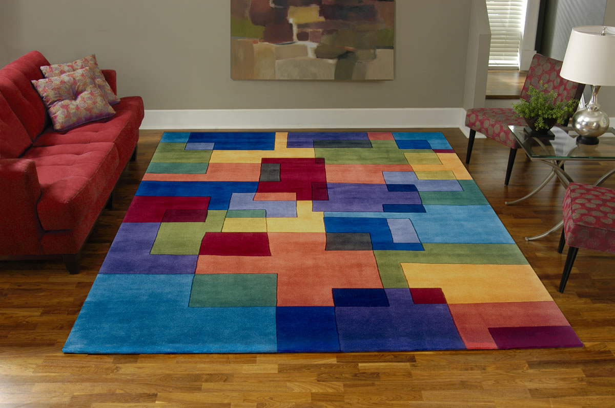 charming colorful checked momeni rugs on wooden floor plus red sofa for living room decor ideas