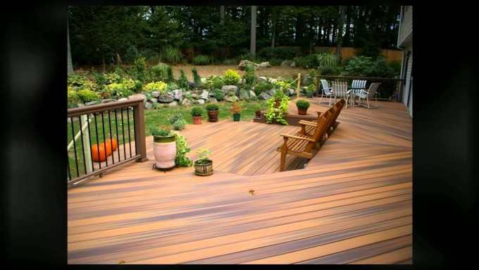 Charming Deck In Wooden Brown With Standard Trex Decking Cost Matched With Wooden Railing Plus Wooden Chairs For Patio Decor Ideas